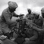 Sikh tying turban to a British soldier in World war 1